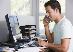 Man on phone in home office